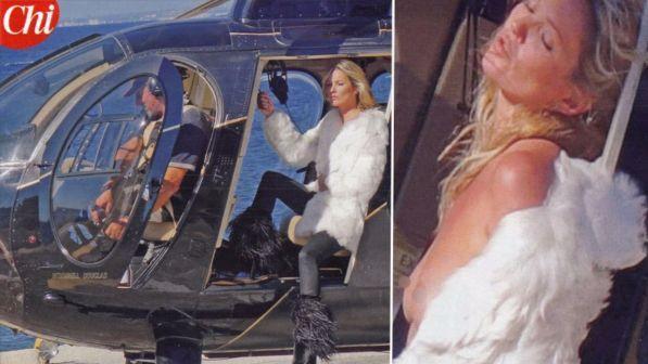 Kate Moss, topless e pelliccia a Ischia