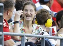 Amanda Knox, center, who was acquitted of murder charges in the 2007 death of her British roommate Meredith Kercher, in Perugia, Italy, smiles as she attends a Copa America Centenario soccer match between Haiti and Peru, Saturday, June 4, 2016, in Seattle. (ANSA/AP Photo/Ted S. Warren) [CopyrightNotice: Copyright 2016 The Associated Press. All rights reserved. This material may not be published, broadcast, rewritten or redistribu]